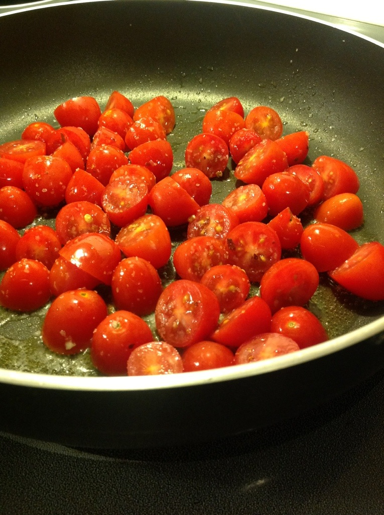 Sautéing crushed cherry tomatoes