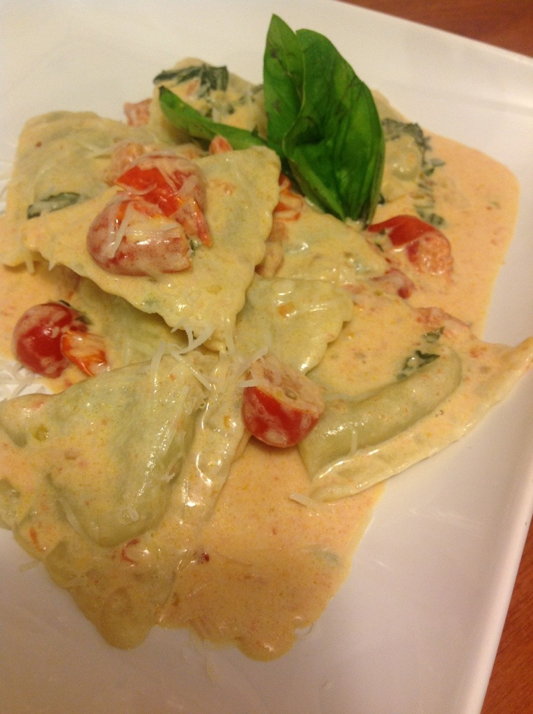 Spinach ravioli in tomato basil cream sauce